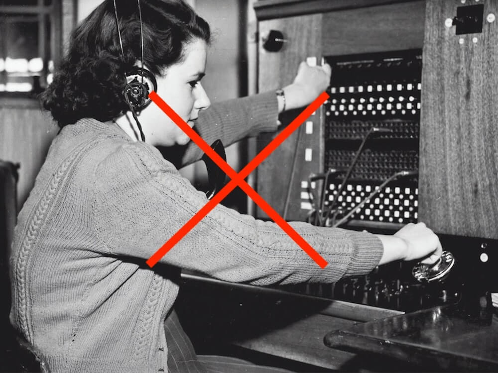 old world reception switchboard operator with red cross